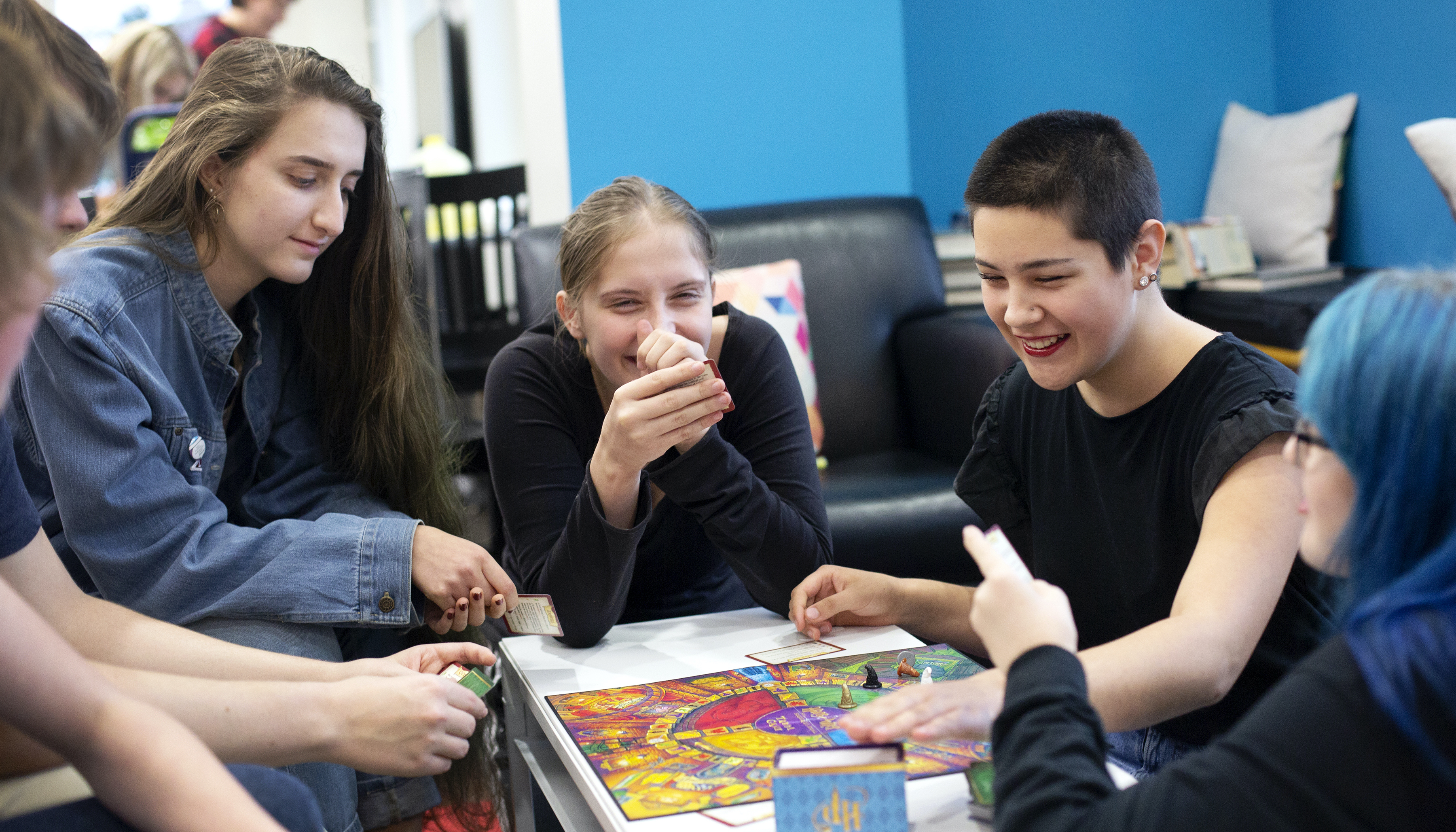 Teens play board games in the library's teen section