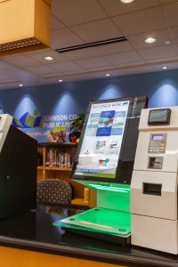 The Library's Self-Checkout station sitting on the front desk