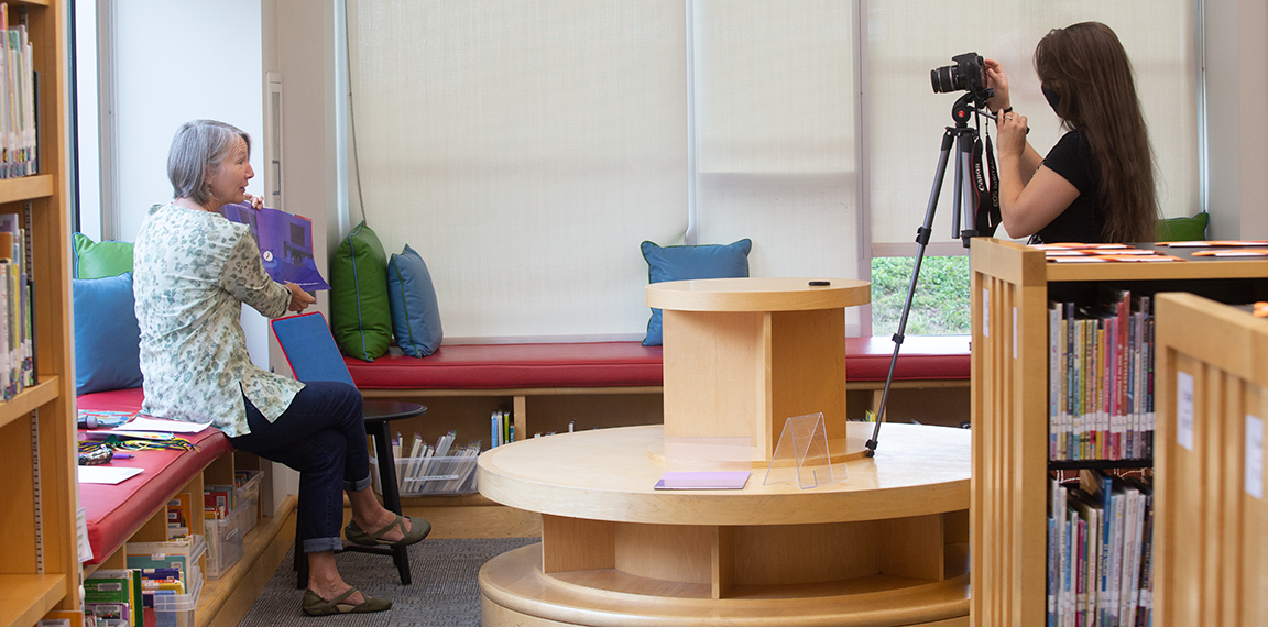 Library employees film a video for online storytime or readers on the road