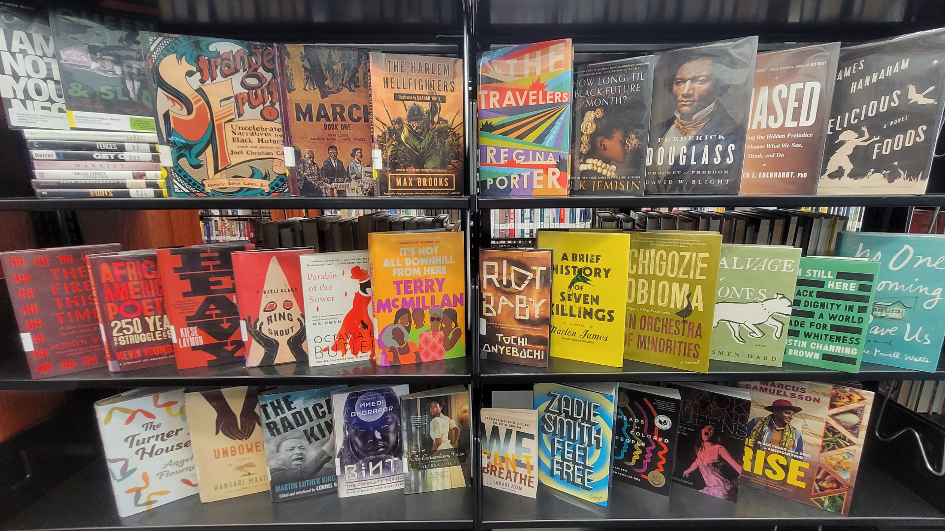 An array of fiction and nonfiction books are lined on a shelf for the Black History Month Online Book Display